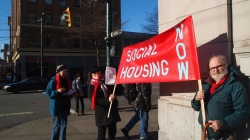 photo of a STAND for Social Housing at the corner of Main and Hastings